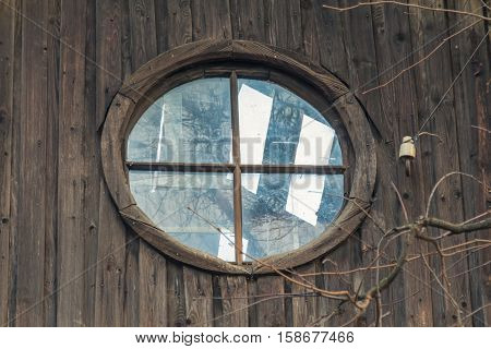 Round attic window in a deserted house