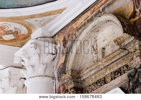 Transfiguration Cathedral in Uglich Kremlin Russia. Gold ring. Details of an old Russian Cathedral. Stucco molding painting fresco. Entry group