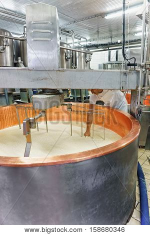 Evillers, France - August 31, 2016: Processing of Gruyere de Comte Cheese at the dairy in Franche Comte Burgundy France.
