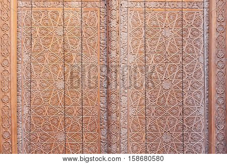 Carved wooden door at the Mir-i-Arab Madrasah at the Poi-Kalyan complex in the historic centre of Bukhara Uzbekistan.