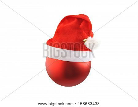 Christmas red ball with Santa hat isolated over white. Christmas and New Year theme.