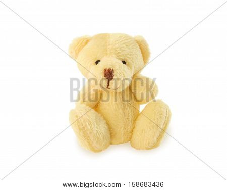 Sitting teddy bear classic soft toy isolated over white. Front view.
