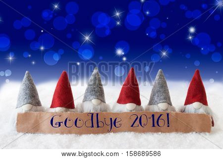 Label With English Text Goodbye 2016 For Happy New Year. Christmas Greeting Card With Gnomes. Sparkling Bokeh And Blue Background With Snow And Stars.