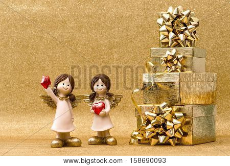 Gift boxes and little guardian angels. Christmas holidays decoration