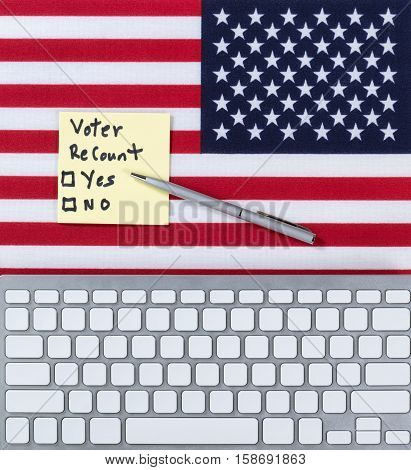 Keyboard with USA Flag and decision paper to do a recount on the election.
