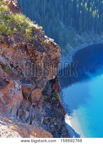 The jagged cliffs of Crater Lake on a sunny summer morning.