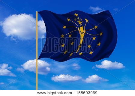 Flag of the US state of Indiana. American patriotic element. USA banner. United States of America symbol. Indianian official flag on flagpole waving in the wind blue sky background. Fabric texture. 3D rendered illustration