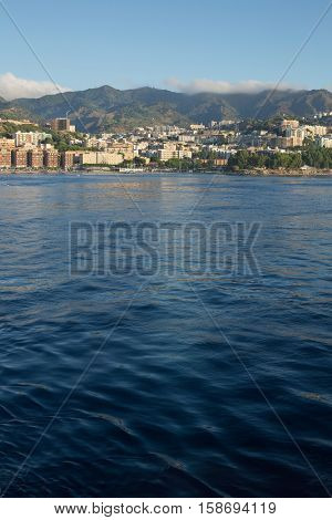 View from the stern of the ship Overlooking the coast of Messina, Sicily, Italy