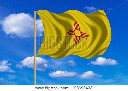 Flag of the US state of New Mexico. American patriotic element. USA banner. United States of America symbol. New Mexican official flag on flagpole waving in the wind blue sky background Fabric texture. 3D rendered illustration