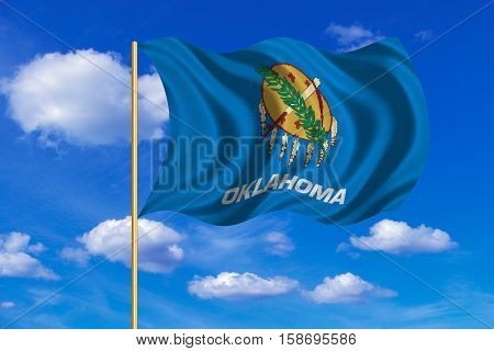 Flag of the US state of Oklahoma. American patriotic element. USA banner. United States of America symbol. Oklahoman official flag on flagpole waving in the wind blue sky background. Fabric texture. 3D rendered illustration
