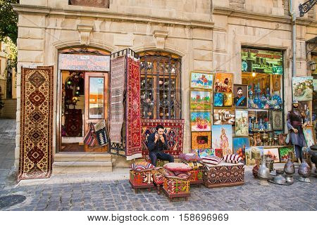 BAKU,AZERBAIJAN- OCT, 2016: Souvenir shop in Icheri Sheher (Old Town) of Baku on Oct 3, 2016, Azerbaijan. Typical tourist shop with souvenirs and antiques.
