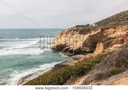 Eroded cliffs along the ocean at the Point Loma tidepools in San Diego, California.