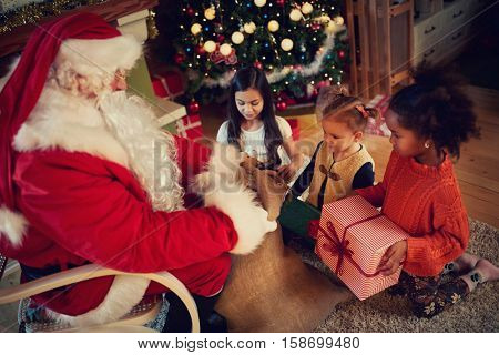 Real Santa Claus gives presents, childhood in Christmas time