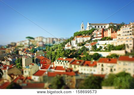 Miniature or tilt-shift effect on a panoramic view of Lisbon, capital and the largest city of Portugal.