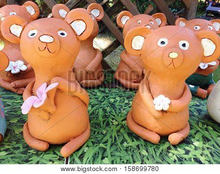 Happy bear soil doll or cute bear soil doll decorative in the garden