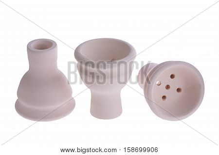 hookah bowl for tobacco shisha three ceramic products with short legs, three beige pottery with five holes, three clay bowls arranged in a row, three ceramic vessels, one vessel stands right and second reversed and third lays