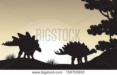 Silhouette of two stegosaurus scenery vector illustration