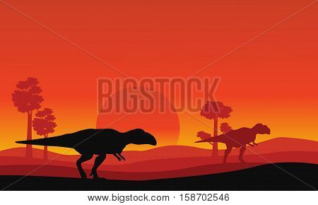 Silhouette of mapusaurus orange sky scenery collection stock