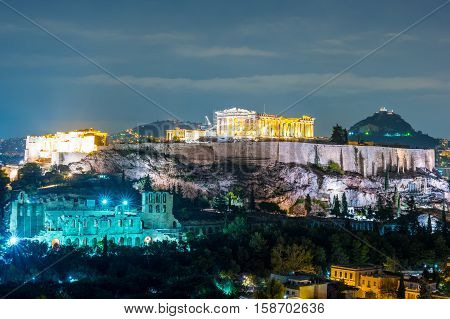 Parthenon and Herodium construction in Acropolis Hill in Athens, Greece shot in blue hour