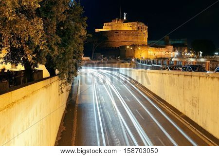 Castel Sant Angelo in Italy Rome at night with traffic light trails