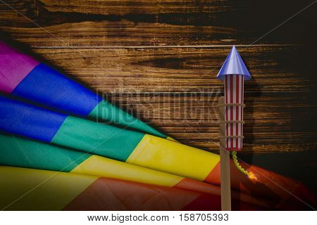 3D Rocket for fireworks against pride flag on table