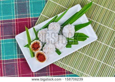 Thai desert Steamed flour with minced coconut wrap sweet mashed coconut as