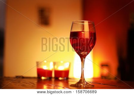 Red Wine In Glass With A Living Room Background