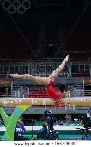 RIO DE JANEIRO, BRAZIL - AUGUST 4, 2016: Olympic champion Laurie Hernandez of United States practices on the balance beam before women's all-around gymnastics at Rio 2016 Olympic Games