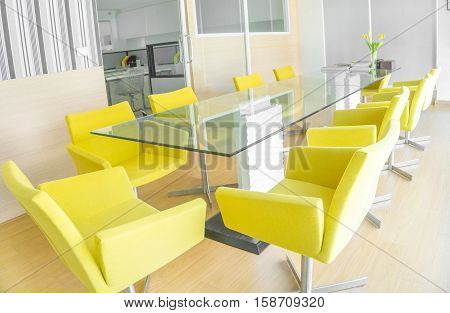 Business and meeting concept - Modern meeting room with woof floor glass table yellow seat