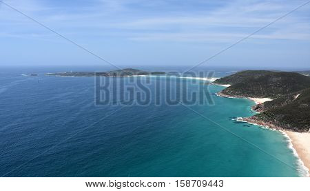 Shark Island and coastline of Shoal bay on a sunny day from Mount Tomaree Lookout (Central Coast NSW Australia)