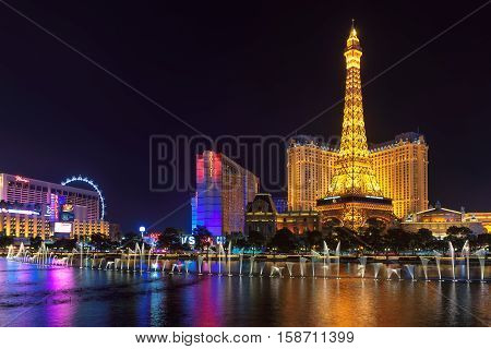 Las Vegas, USA - JULY 4, 2016: Bellagio fountain show and Paris hotel and casino on July 4, 2016 in Las Vegas, USA.