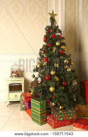 christmas decorated tree with fire place and presents close up photo