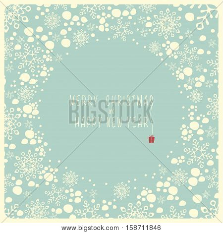 The cover design. Depicts snowflakes and the snow on the blue background. In the center of the blue circle with the words merry Christmas and a happy New year.