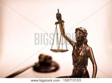 Statue of justice and Wooden gavel, law concept