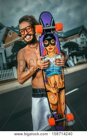 Skating man with sexy hand painting skateboard
