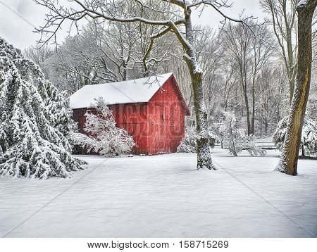 Red Barn with snow after  winter snow storm