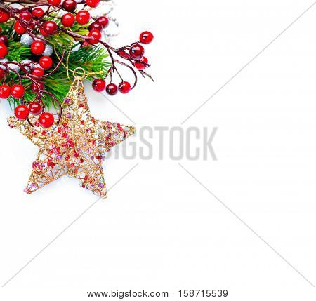 Christmas and New Year Decoration isolated on white background. Border art design with holiday baubles. Beautiful Christmas tree closeup decorated with star, holly berry, tinsel. Space for your text