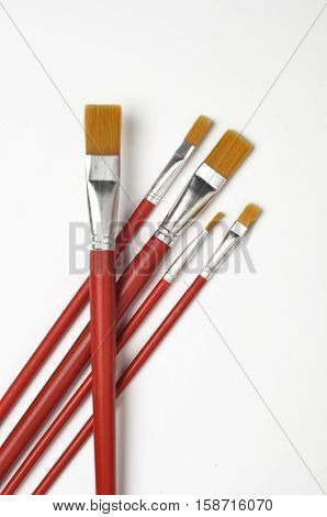 Set of unused, clean paint brushes on white background. Painters' tool and art material.