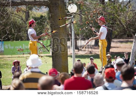 Acrobats And Flame Jugglers Busking