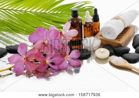 spa still life with orchid with towel and fern leaf ,candle on towel