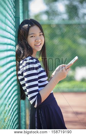 asian teen age and computer tablet in hand