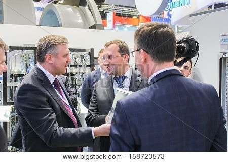 St. Petersburg, Russia - 5 October, Communication of business people in the stands, 5 October, 2016. Petersburg Gas Forum which takes place in Expoforum.
