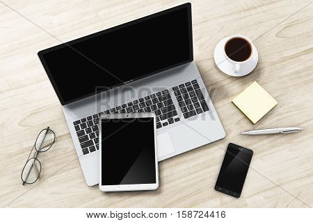 3D render illustration of laptop or notebook, tablet computer PC, modern black glossy touchscreen smartphone or mobile phone, eyeglasses, ballpoint pen, sticker note paper and cup or mug of fresh coffee on wooden office table