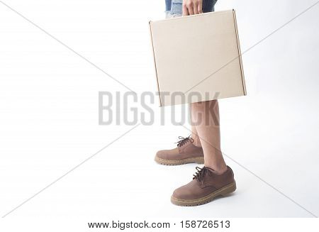 women legs in leather boots fashion and hand holding paper box side view isolated on the white background.