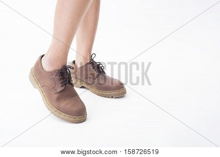 women legs in leather boots fashion side view isolated on the white background.