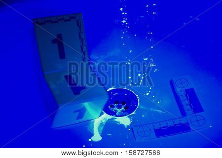 Collecting of evidences under UV light in bathroom