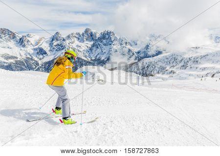 Teenage girl skiing in Italian Alps in Sunny Day, San Martino di Castrozza, Trentino, Italy.