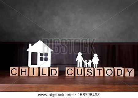 Cubes with text CHILD CUSTODY on wooden table