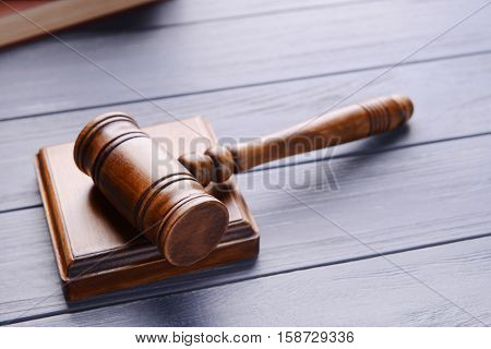 Gavel with sound block on wooden background
