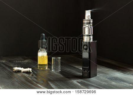 Vape Or E-cigarette. Vaping Set On The Table.